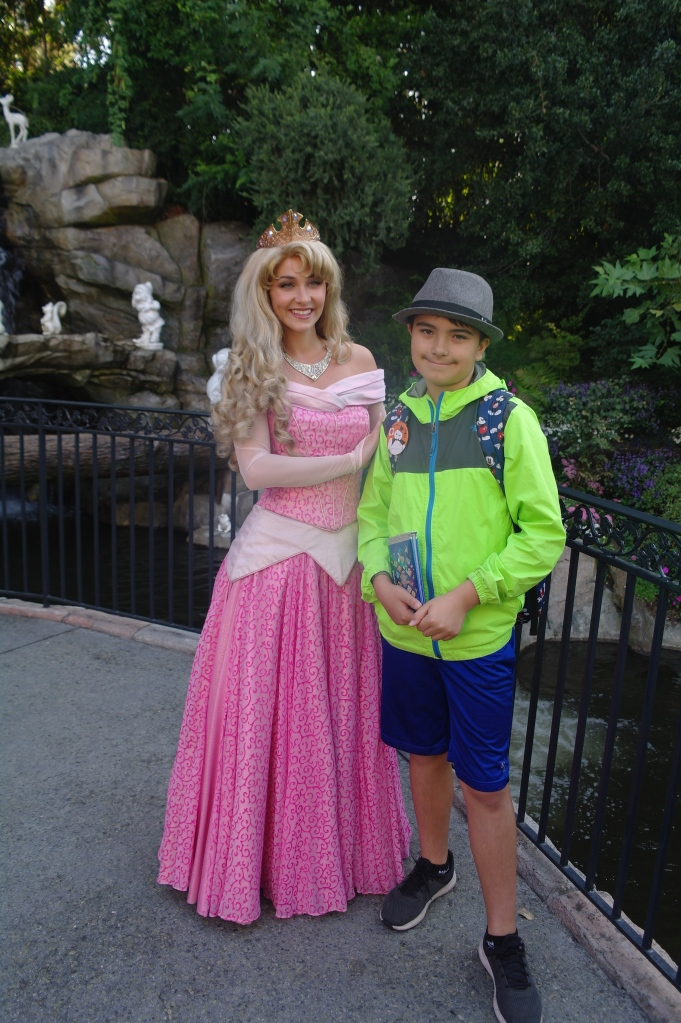 Boy posing with Sleeping Beauty in Disneyland